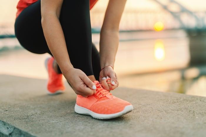 Woman tying a sportswear shoe.