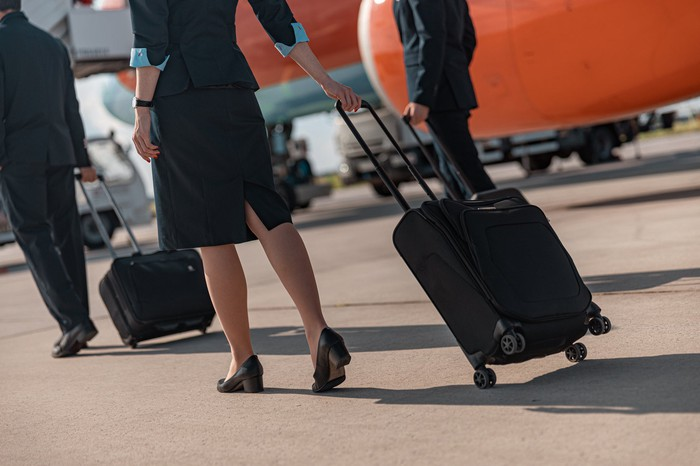 Flight attendant walking on tarmac