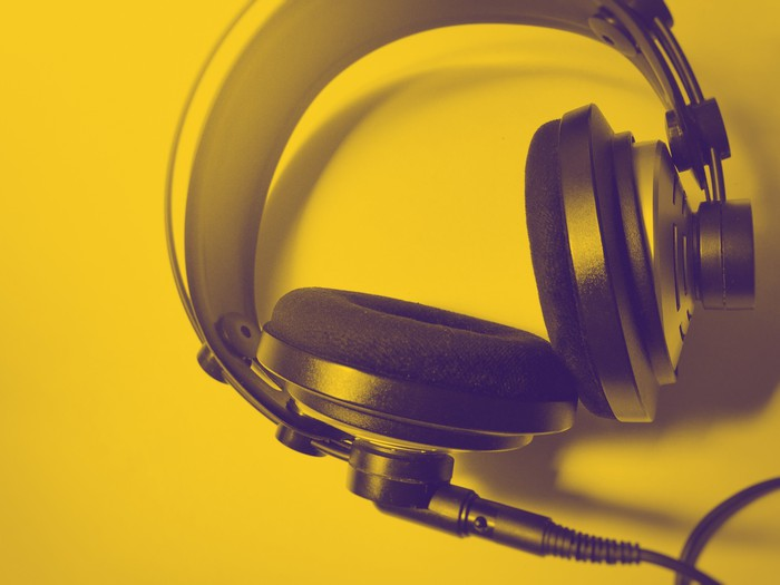 Headphones with a yellow background.