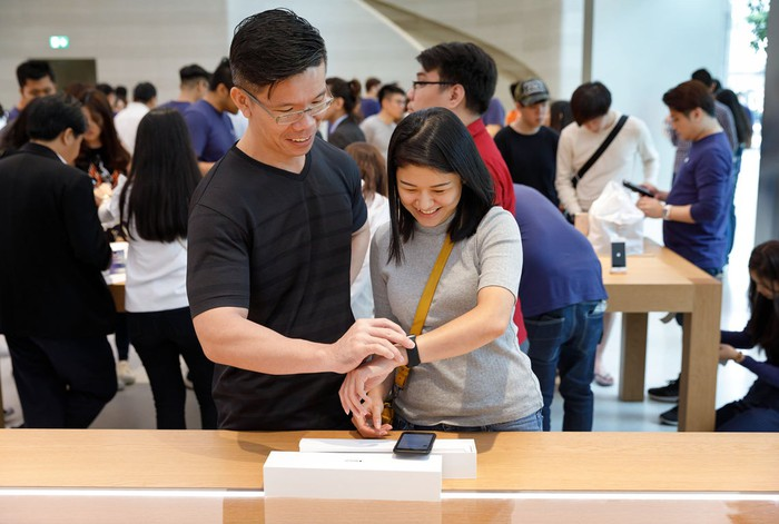 Asian customers in an Apple Store