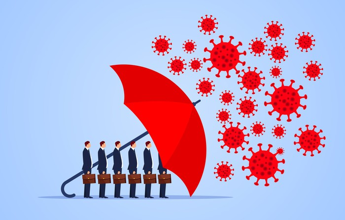 A red umbrella protecting several men in suits from a virus.