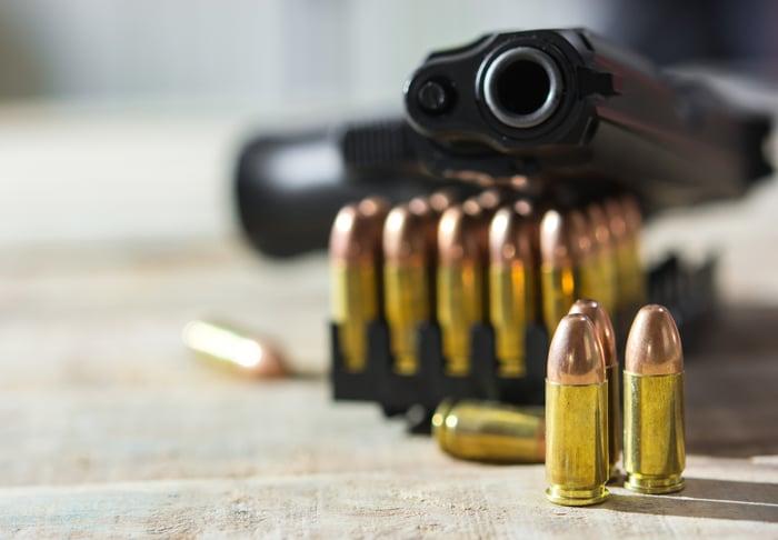 A handgun and several bullets.