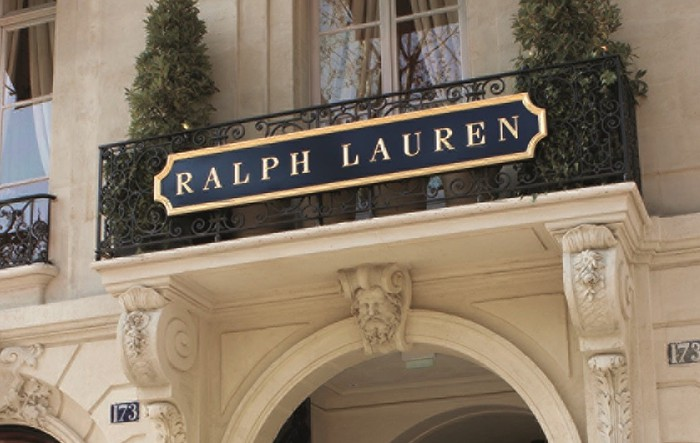 A close-up of the Ralph Lauren sign on the outside of the company's store in Paris.