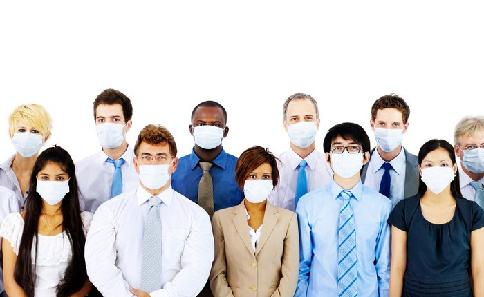 Group of people wearing surgical masks.