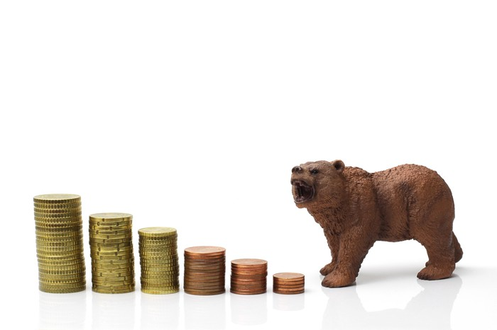 Bear and diminishing stacks of coins