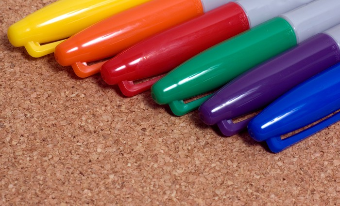 Six Sharpie markers of various colors arranged together