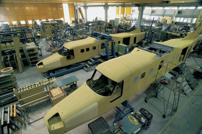 Airplanes on the assembly line.