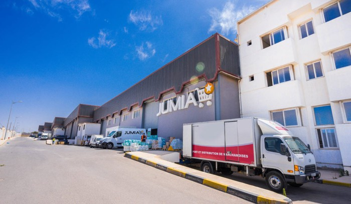 A street scene shows the front of a Jumia warehouse in Morocco.