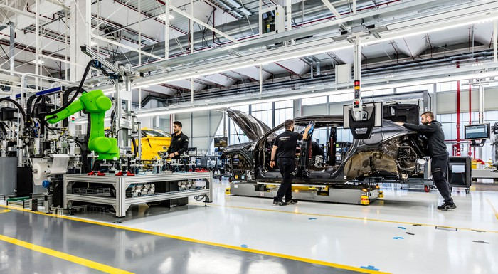 The floor of Lamborghini's factory, with several partially-assembled vehicles visible.