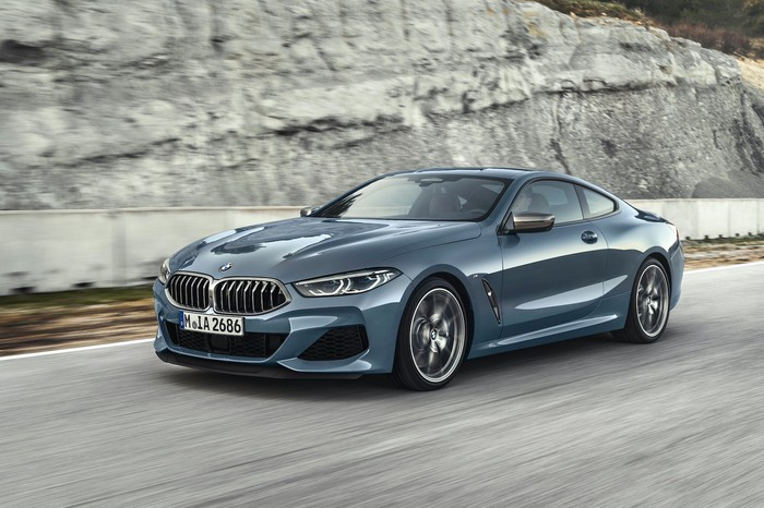 A blue BMW 8 Series, a luxury coupe.