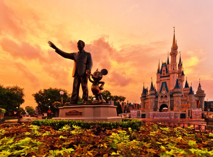A statue at Walt Disney World during sunset.