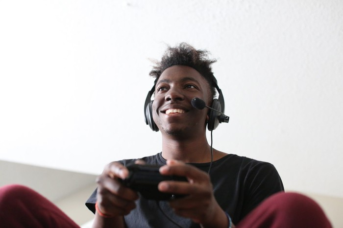 A young man playing a console video game.