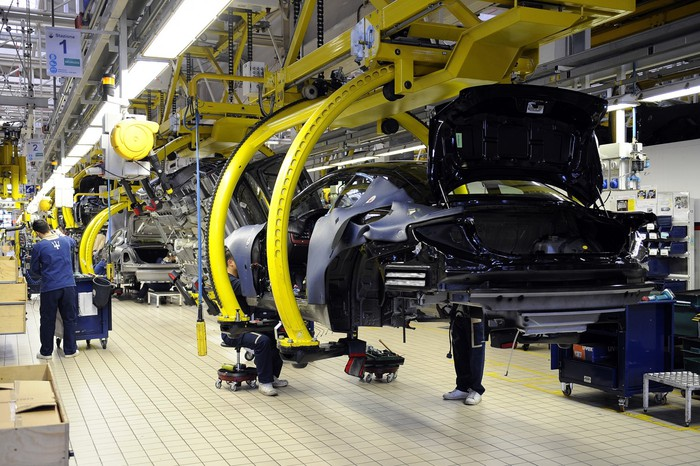 Partially-assembled Maserati cars on a factory production line.