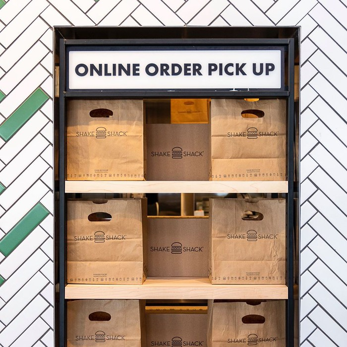 Shake Shack bags ready for online order pick-up.