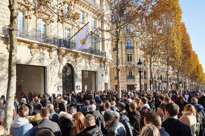 Champs Elysees Apple Store exterior shot with crowds of people outside