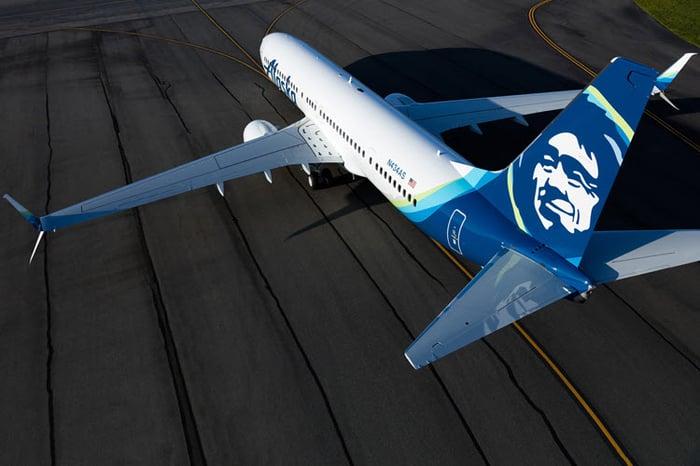 An Alaska Air plane on the runway.