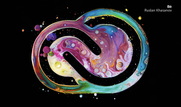 Adobe's Creative Cloud software logo rendered in multiple colors of paint