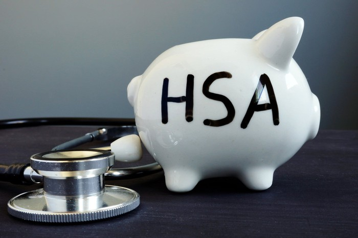 White piggy bank with HSA written on it in black