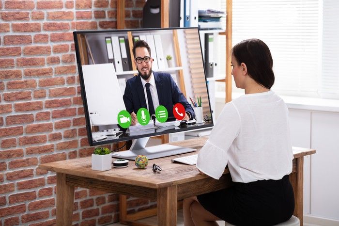Woman having a video conference with a co-worker.