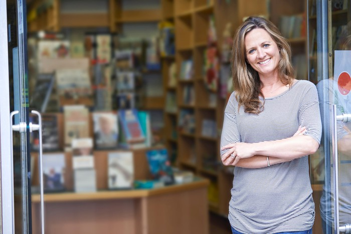 Smiling woman in front of bookstore