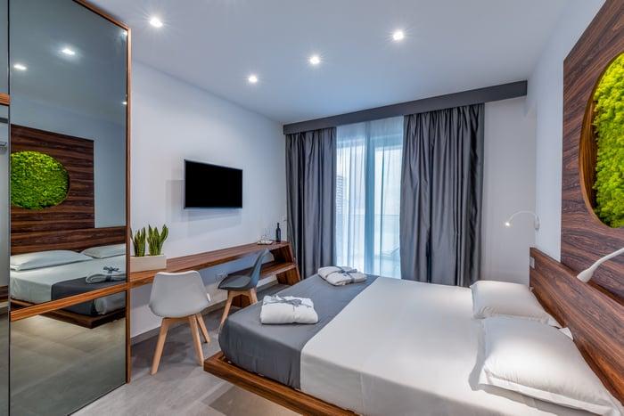 A modern, eco-friendly hotel room interior.
