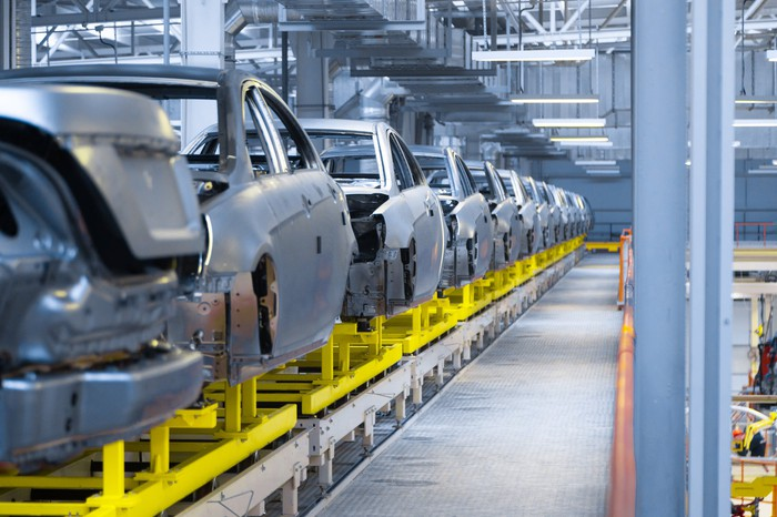 Cars along a production line at a factory.