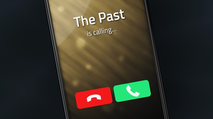 """smart phone displaying the words: """"the past is calling."""""""