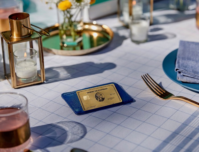 American Express gold card on a table.