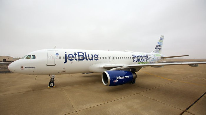 A JetBlue aircraft parked on the tarmac.