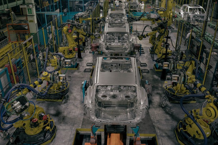 Partially-assembled Acura RDX SUVs move down an assembly line amid robots at Honda's plant in East Liberty, Ohio.
