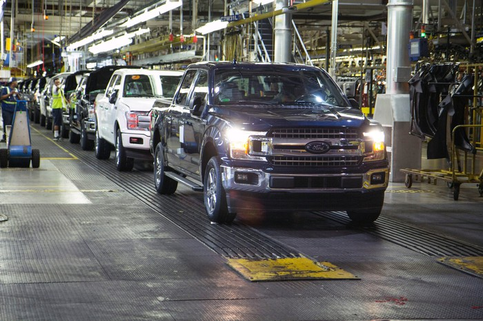 Pickup trucks move down the assembly line at Ford's Dearborn Truck Plant in Dearborn, Michigan.