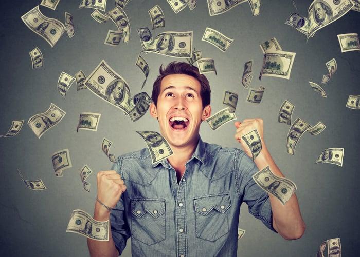 Cash raining down on man
