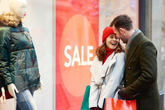 Couple looking at store window