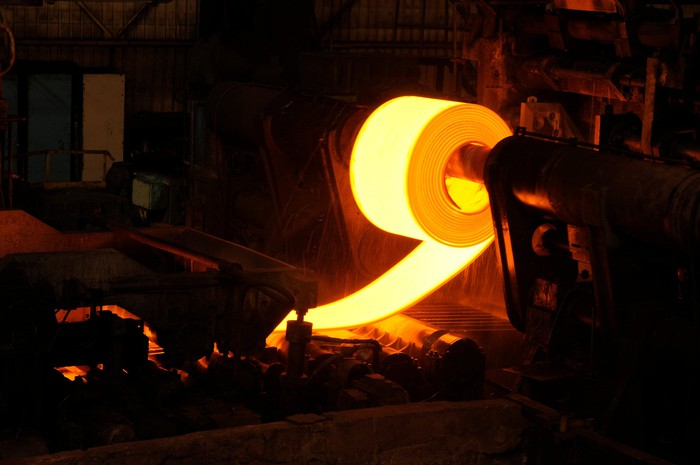 Hot Rolled steel coil being wrapped on a mandrel