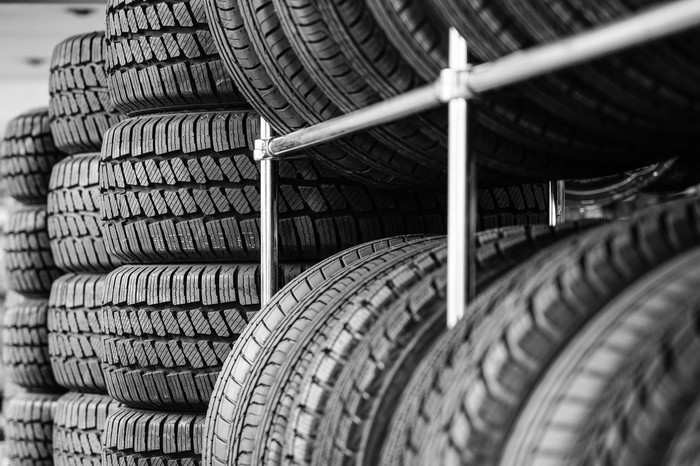 Rows of tires stacked on each other.