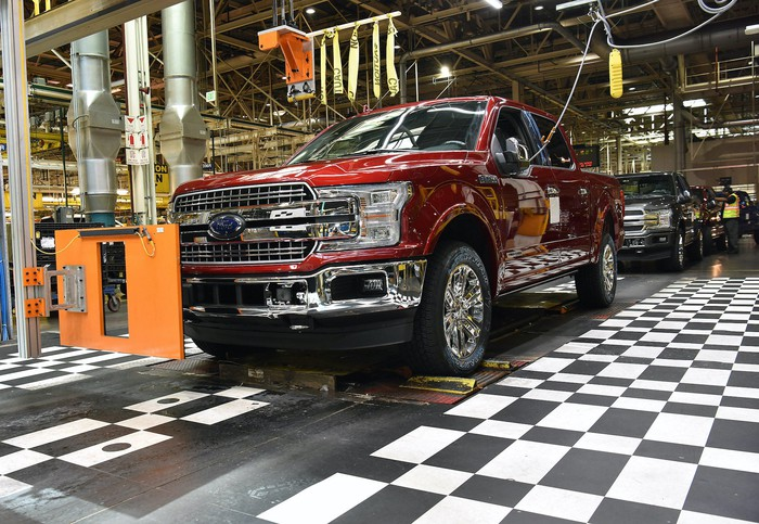 Ford F-150 pickups roll off the production line at the company's Dearborn Truck Plant in Dearborn, Michigan.