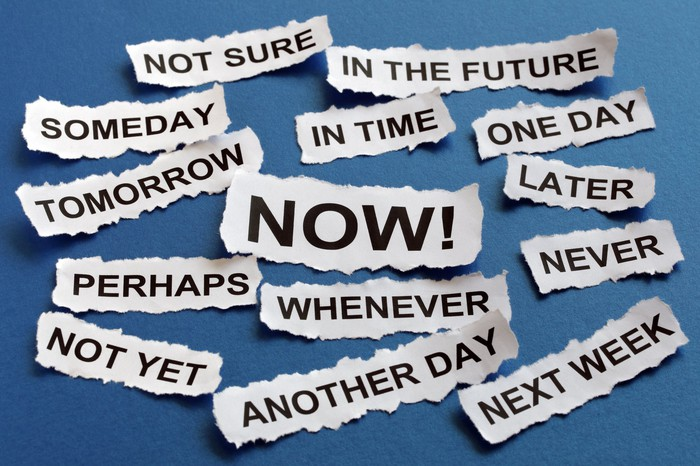 """Slips of paper with words printed for different levels of urgency, including """"now,"""" """"someday,"""" """"later,"""" """"another day,"""" and """"next week"""""""