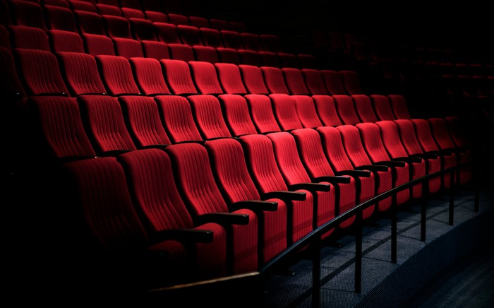 A side movie of a movie theater with rows of empty seats.
