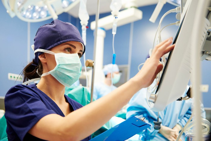 A nurse working in a hospital operating room.