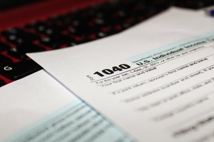 Tax Form 1040 on computer keyboard