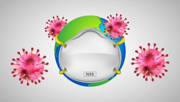 Artist's rendering of N95 respirator mask covering the globe with virus symbols floating around
