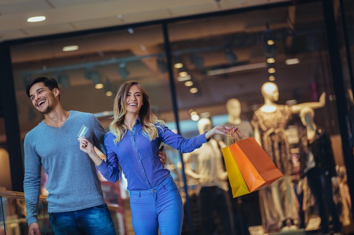 Man and woman shopping at an apparel retailer