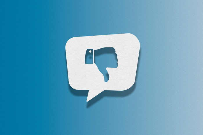 A social media icon of a thumbs down.