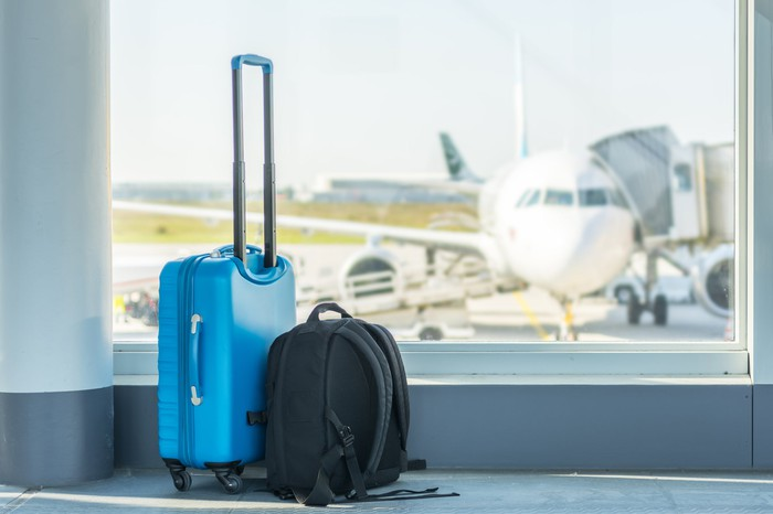 Luggage in front of airport window