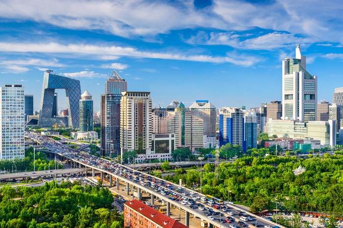 A view of the Beijing skyline from a distance on a clear, bright morning.