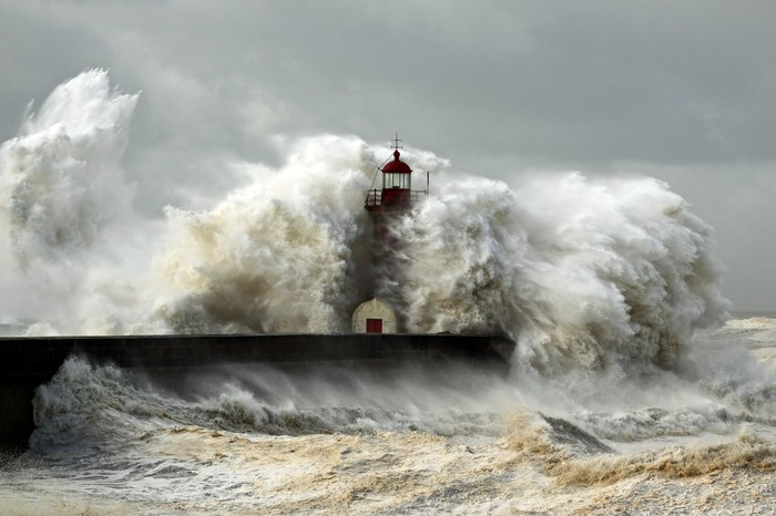 Lighthouse being battered by rough seas
