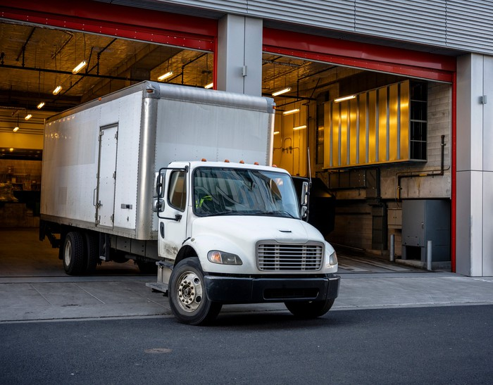 Box truck pulling out of a warehouse