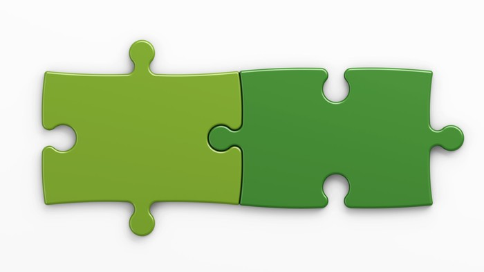 Two green jigsaw puzzle pieces joined together