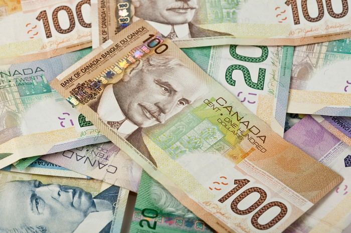 A collection of Canadian paper currency.