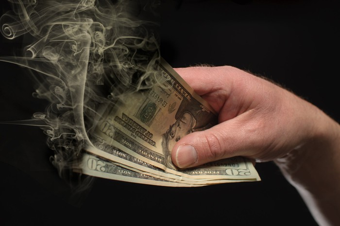 $20 bills being burned.